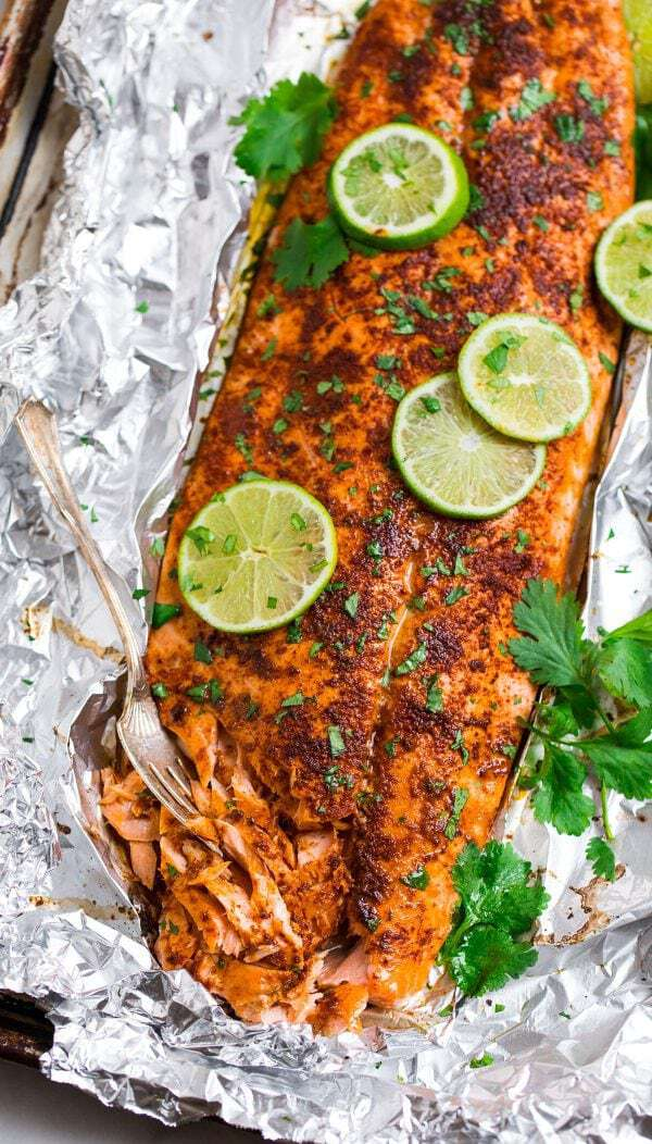 Spicy Baked Salmon in Foil. Flaky, tender salmon with a sweet and spicy chipotle lime rub, this easy, healthy salmon recipe is foolproof and impressive!