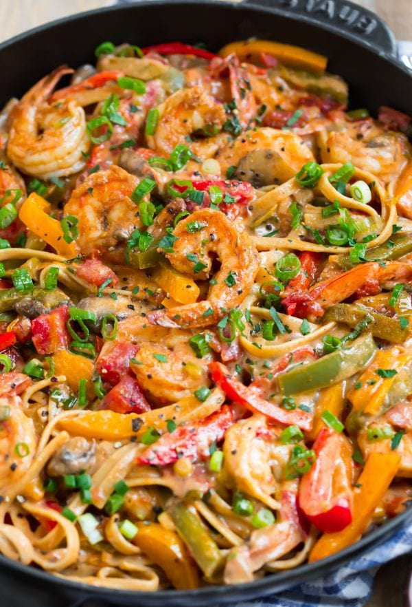 Healthy Cajun Shrimp pasta with shrimp, bell peppers, and mushrooms