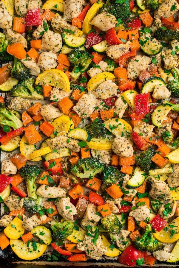 Close up of roasted sheet pan chicken and vegetables