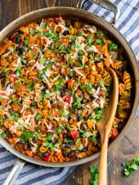 Healthy Taco Pasta with Twirly Noodles, Cheese, and Chicken in a Skillet