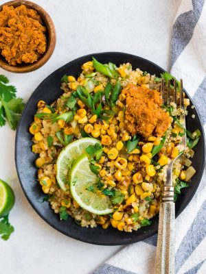 Healthy Mexican Street Corn Salad on a plate with lime