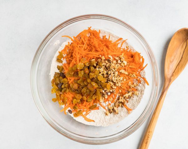 A bowl of ingredients for Carrot Cake Muffins