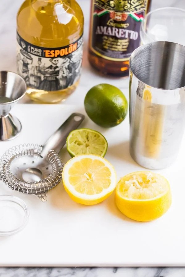 Ingredients and tools for mixing an Italian Margarita