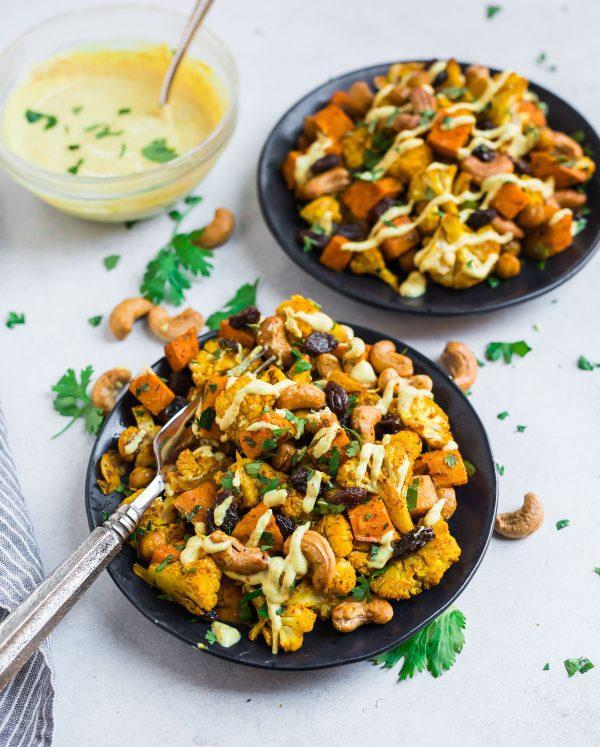 Two plates of Roasted Cauliflower Salad with creamy Greek yogurt curry dressing