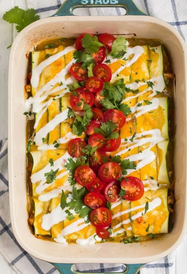 Zucchini Enchiladas topped with tomatoes