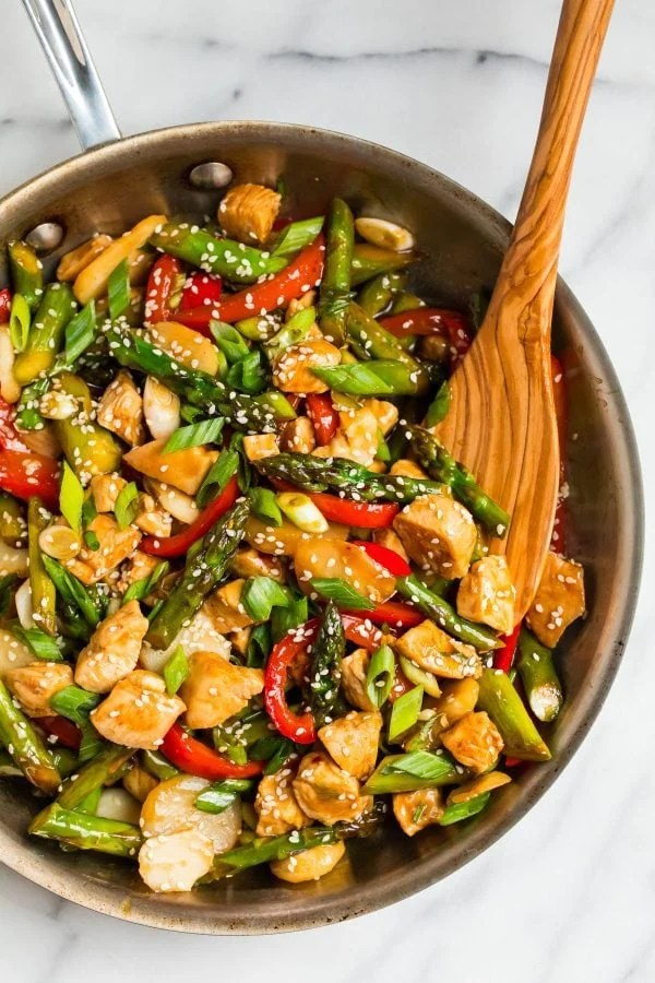 Healthy Teriyaki Chicken Stir Fry in a skillet with vegetables