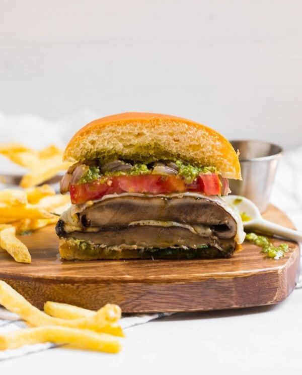 A cross-section of a Portobello Mushroom Burger stuffed with havarti