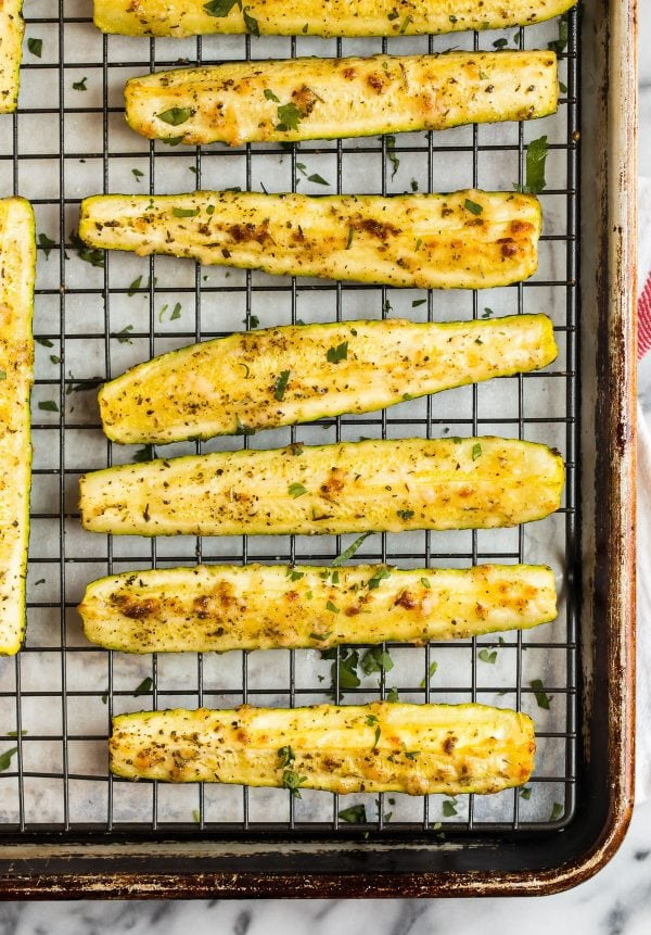 A sheet pan of Roasted Zucchini, baked on a cooling rack