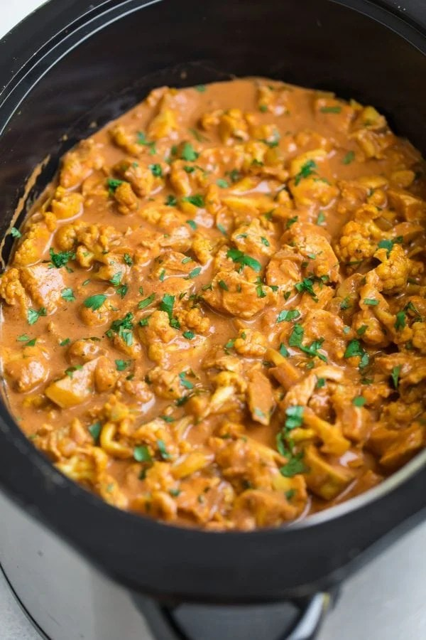 A crock pot full of Slow Cooker Butter Chicken