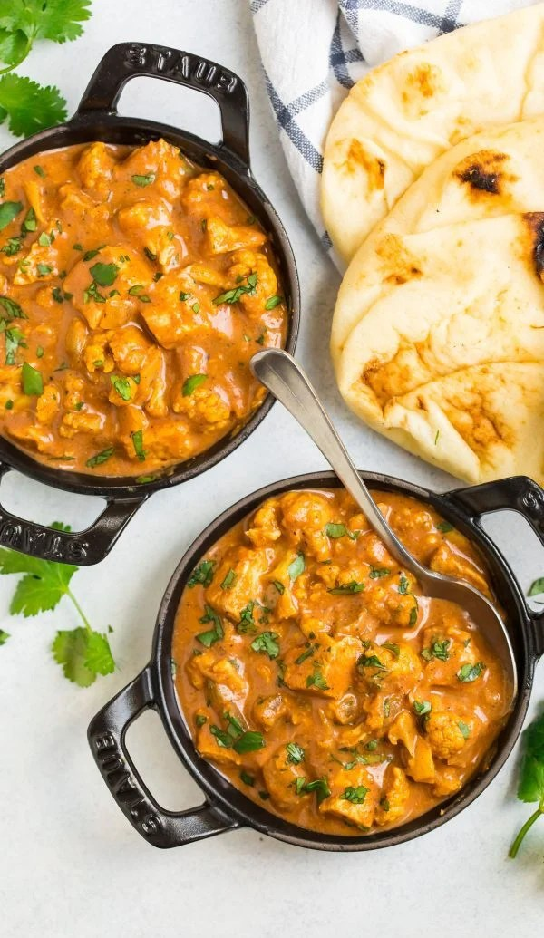 Two Staub casserole dishes of Slow Cooker Butter Chicken
