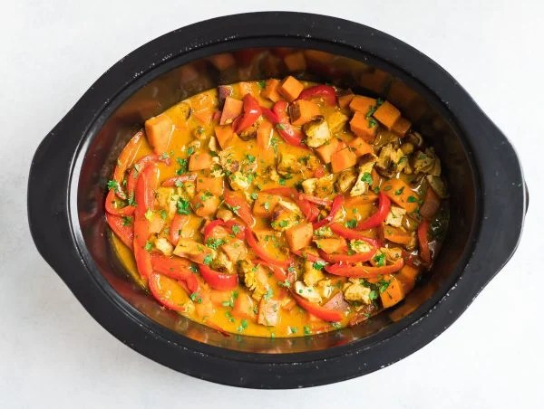 Indian Chicken Curry in a slow cooker with vegetables and coconut milk