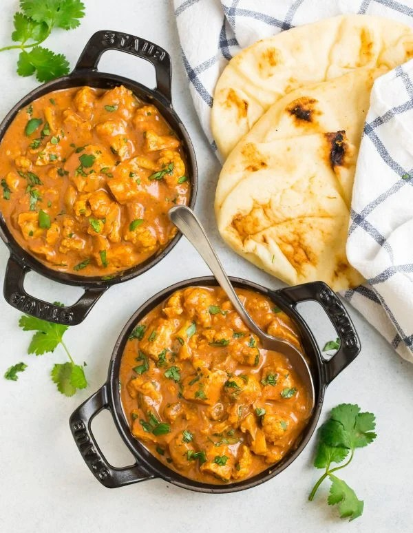 Slow Cooker Butter Chicken served with naan