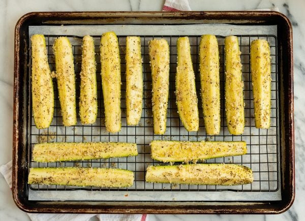 A sheet pan of Roasted Zucchini pre-baking
