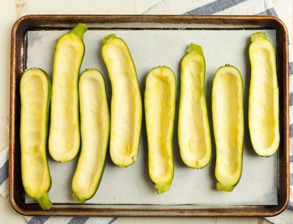 Hollowed out zucchini halves for Zucchini Pizza Boats