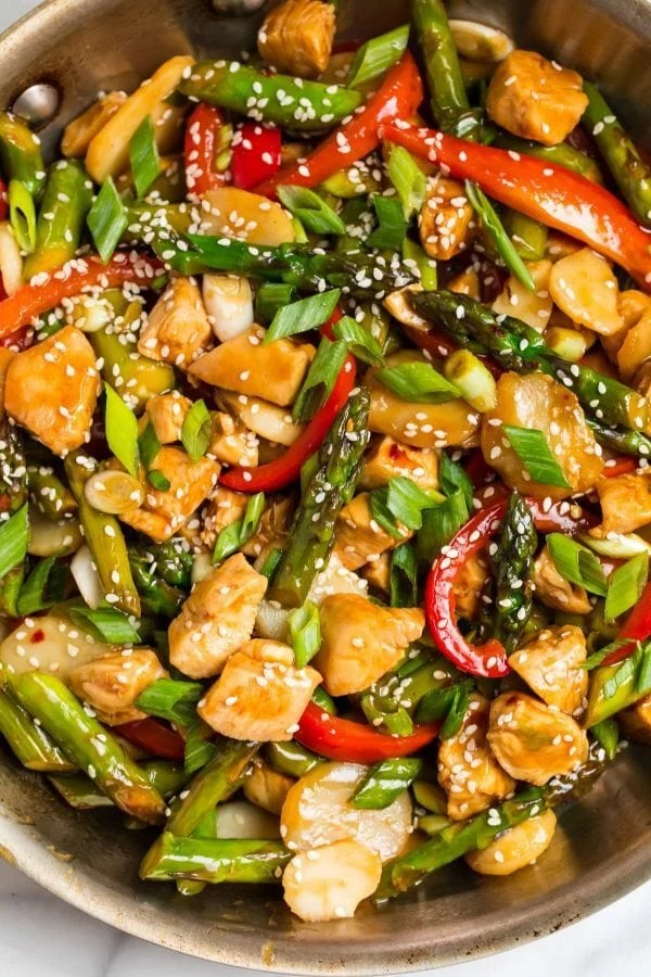 Easy and healthy Teriyaki Chicken Stir Fry in a skillet with vegetables