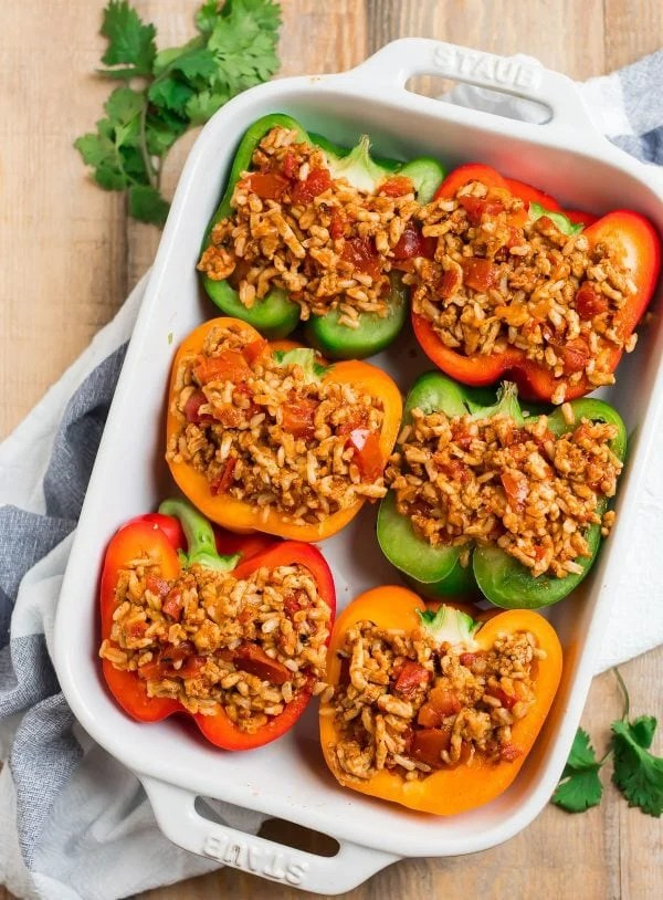 Tasty and healthy Mexican Stuffed Peppers in a baking dish filled with chicken, cheese, and rice