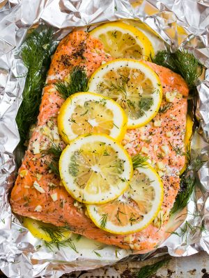 Grilled Salmon in Foil topped with lemon, dill, garlic, and butter