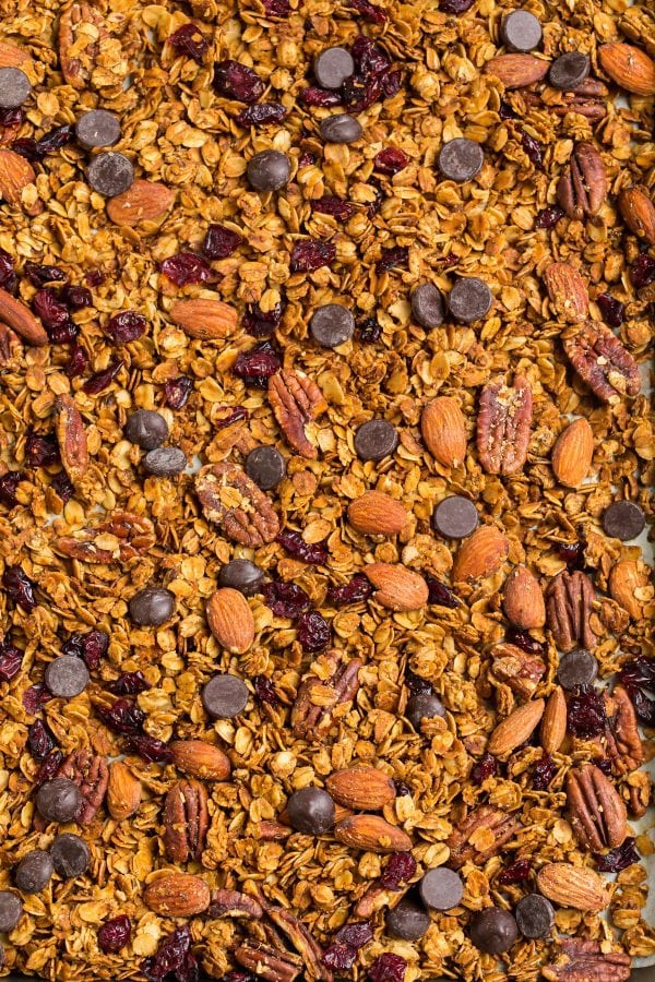 The BEST healthy gluten free granola with on a baking sheet that can easily be made vegan