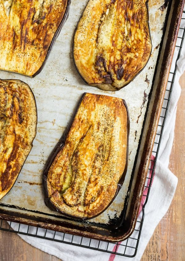 Eggplant slices roasting on a baking try for Eggplant Lasagna.