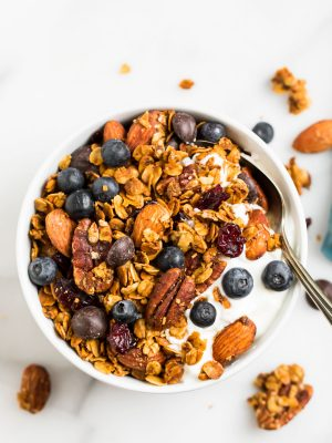 A bowl of the BEST gluten free granola that's make with good for you ingredients like gluten free oats, nuts, coconut, and chocolate chips