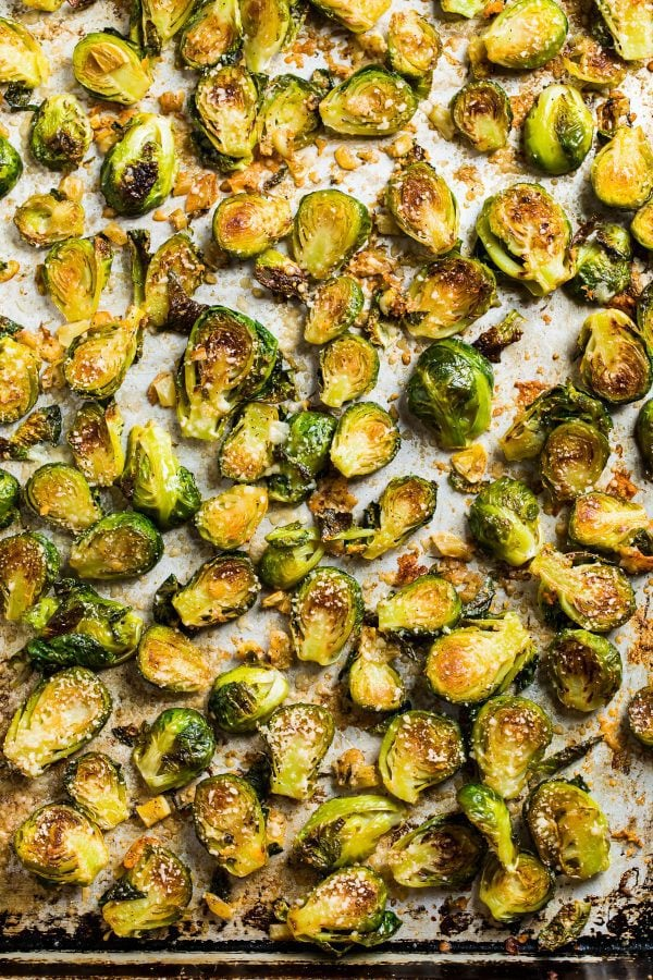 Crispy roasted brussels sprouts with parmesan and garlic on a sheet pan