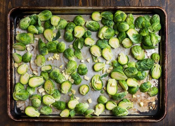 Roasted Brussels Sprouts with Garlic and Parmesan on a baking sheet