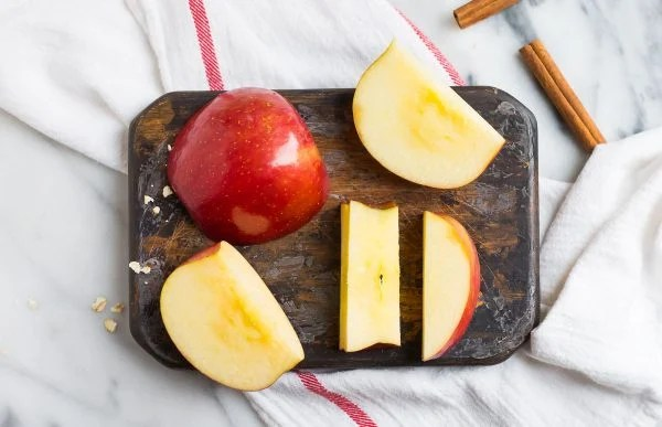 Chopped pieces of apple on a cutting board used to make Apple Smoothie without yogurt