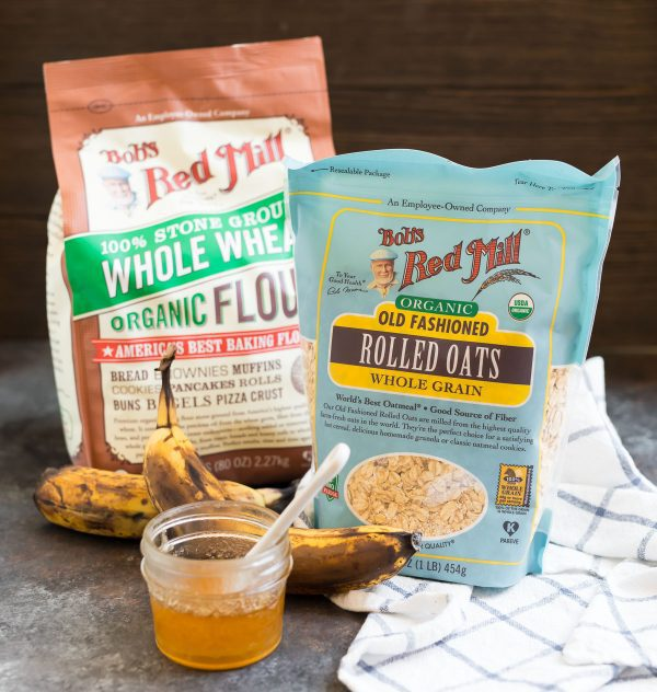 Ingredients to make healthy oatmeal banana bread like rolled oats, whole wheat flour, bananas, and honey