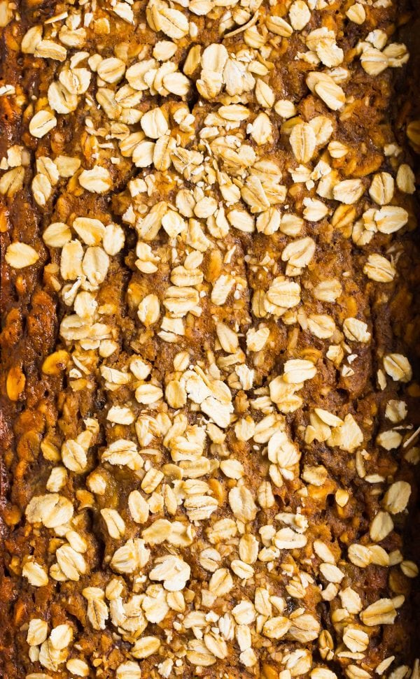 Healthy oatmeal banana bread topped with oats and filled with delicious ingredients