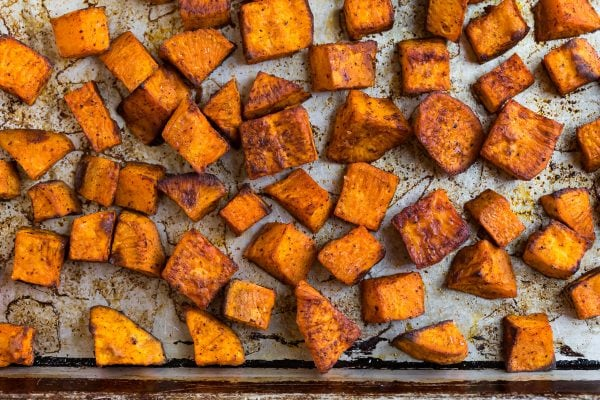 Healthy and delicious sweet potatoes on a sheet pan used for Mexican Salad
