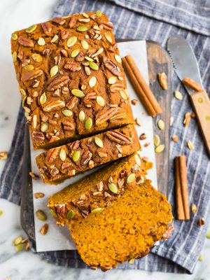 A loaf of moist vegan pumpkin bread made without oil
