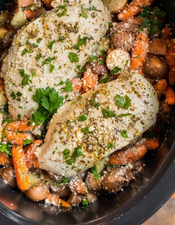 Crockpot Chicken and Potatoes and Carrots in a slow cooker with Parmesan, garlic, and herbs