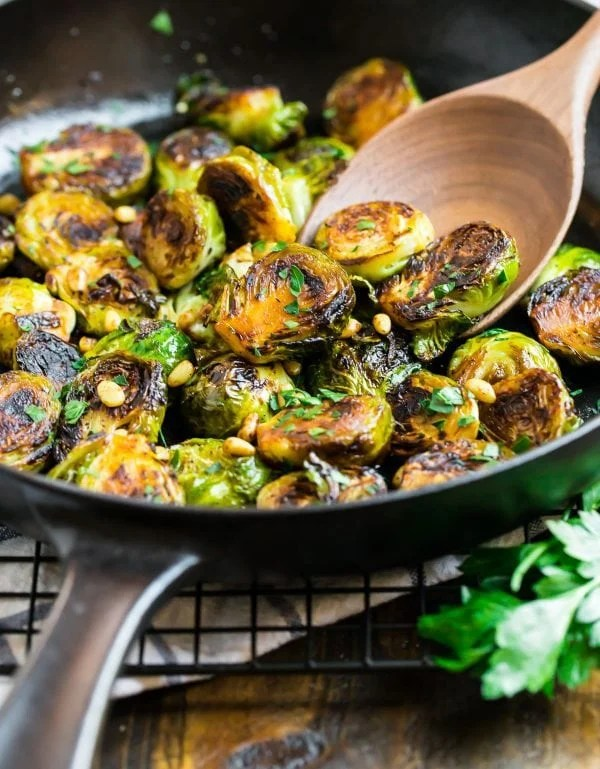 Easy sautéed Brussels sprouts in a skillet with balsamic, Parsley, and pine nuts