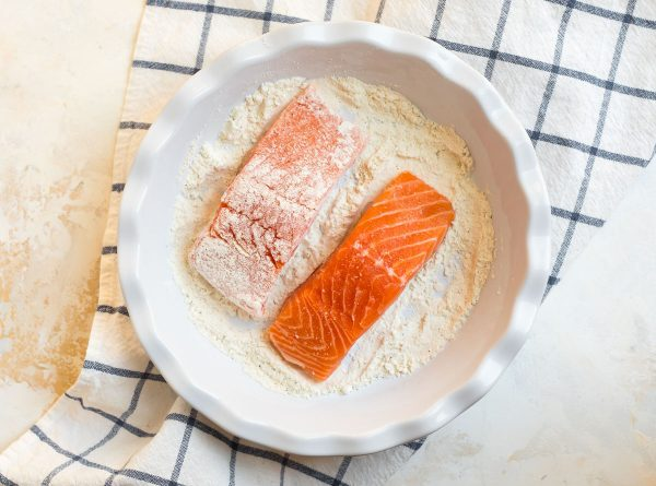 Two salmon fillets dredged in flour mixture for making salmon meuniere
