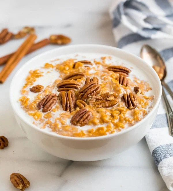 Healthy and delicious pumpkin oatmeal served in a bowl with pecans