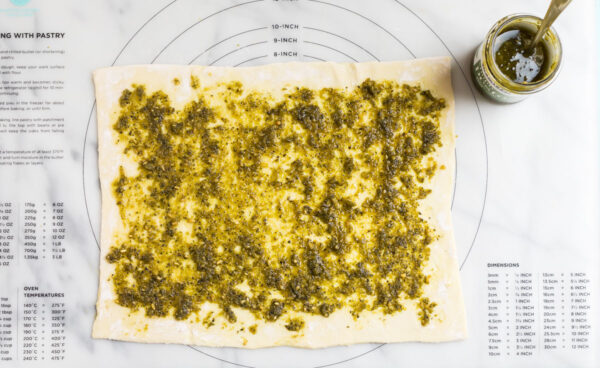 Pesto on puff pastry for making pesto pinwheels