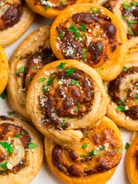 Easy Puff Pastry Pinwheel Appetizers with Pesto and Cheese