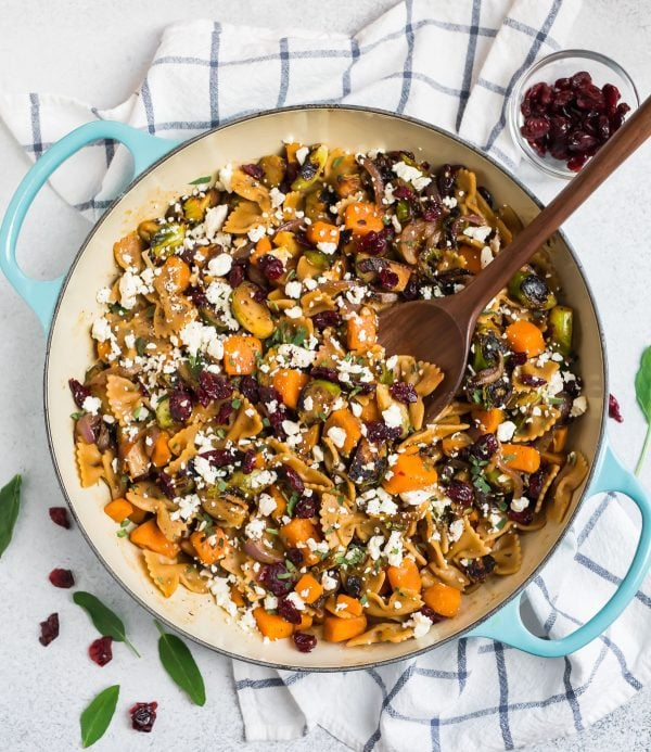 Healthy sweet potato pasta with Brussels sprouts and cranberries in a pot