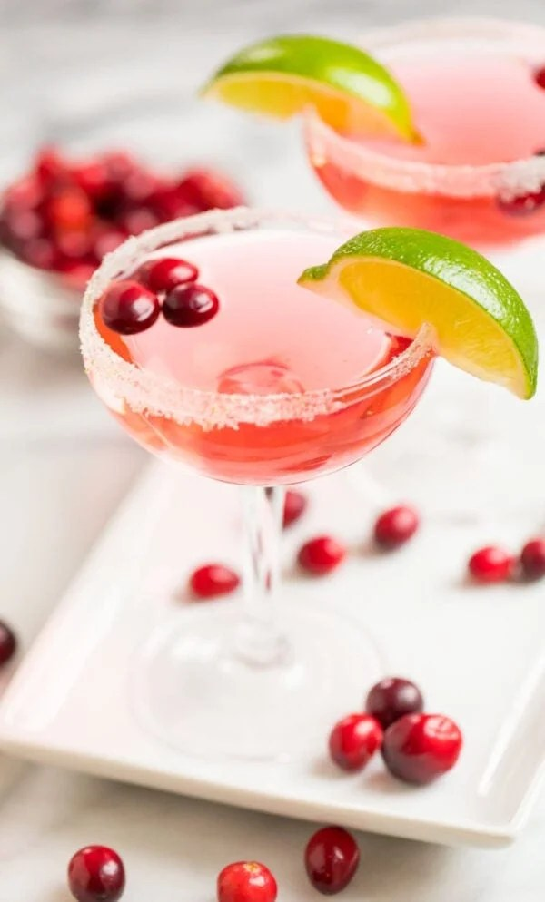 Easy and festive cranberry cocktail served with a lime wedge and cranberries