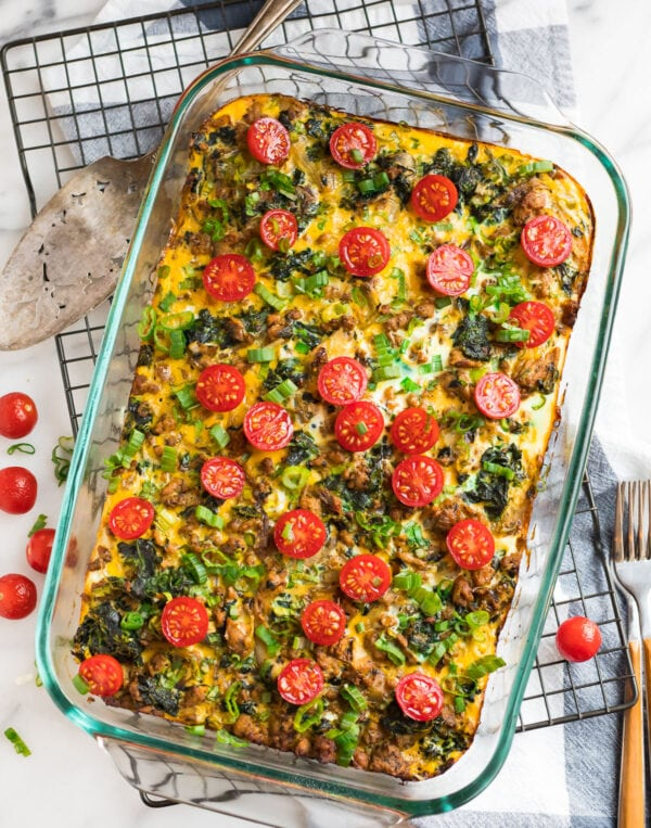Make ahead paleo breakfast casserole in a baking dish topped with tomatoes