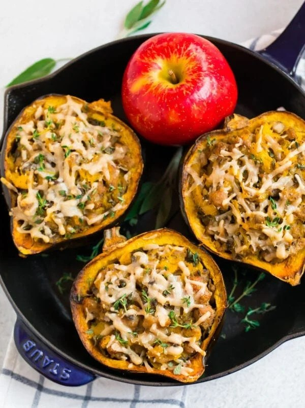 Sausage Stuffed Acorn Squash halves with mushrooms, apples, and thyme