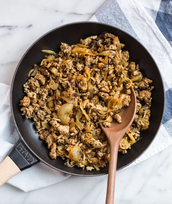 Homemade sausage and onion mixture in a skillet for Whole30 breakfast casserole with potatoes