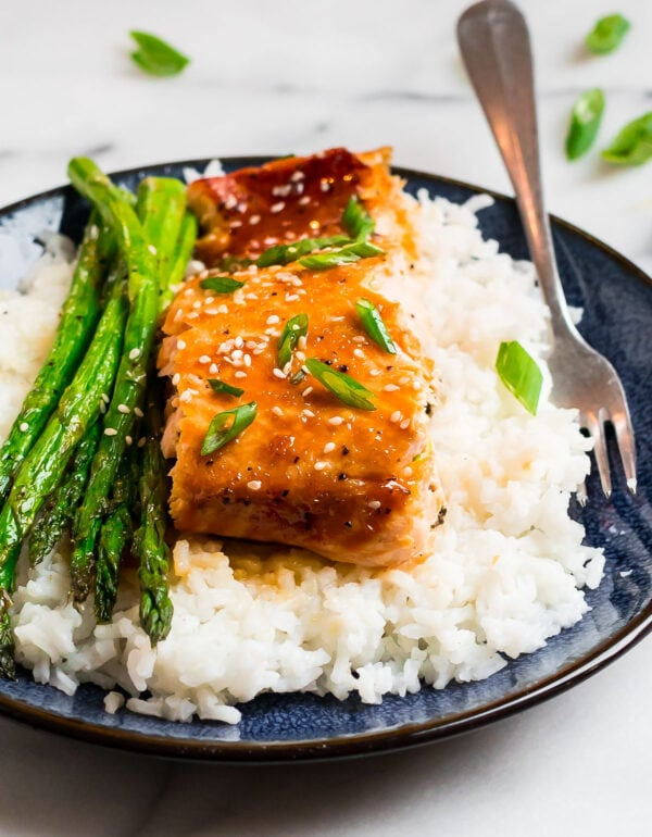A healthy and easy fish recipe served on a plate with rice and asparagus
