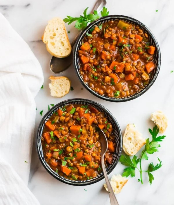 Two bowls of healthy and delicious hearty soup with lentils