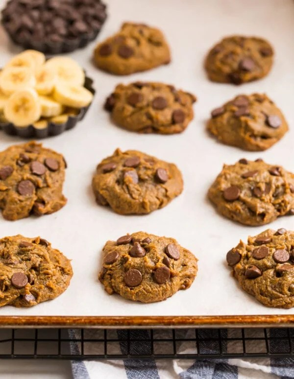 Chewy peanut butter banana cookies on a baking sheet