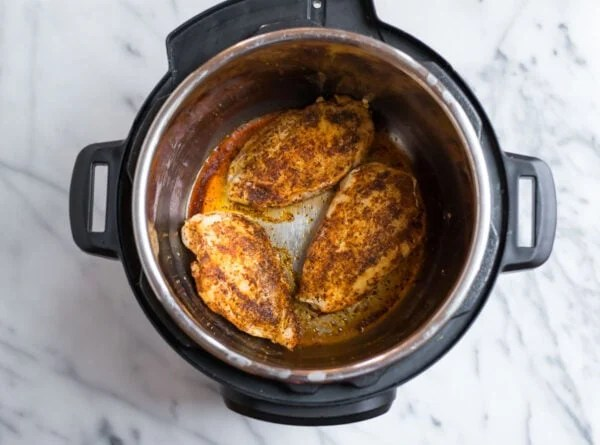 Chicken breasts rubbed with spices in an Instant Pot