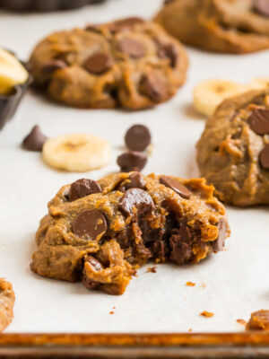 Soft peanut butter banana cookies with chocolate chips on a cookie sheet