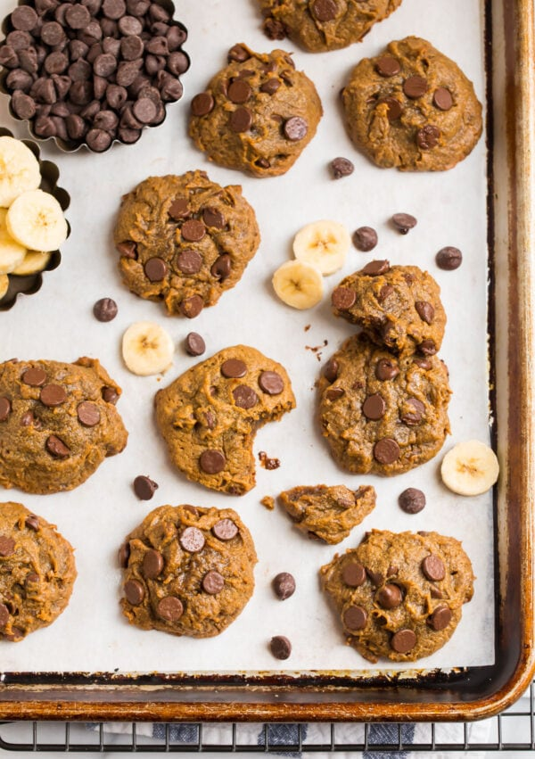 A baking sheet with melt-in-your-mouth peanut butter cookies, chocolate chips, and bananas
