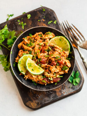 A bowl filled with shredded Mexican chicken made in the slow cooker
