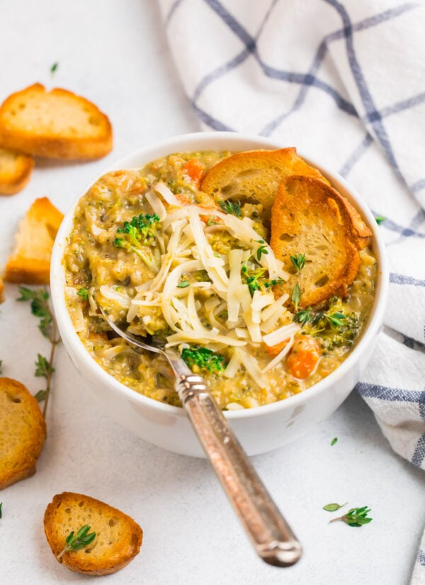 A bowl of healthy soup made with broccoli, cauliflower, cheese, and carrots
